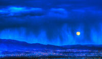 Moonrise and verga over Albuquerque
