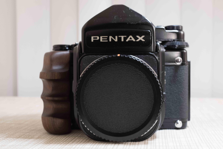 Sold: Pentax 67 with std metered prism + Eye level Prism finder +
